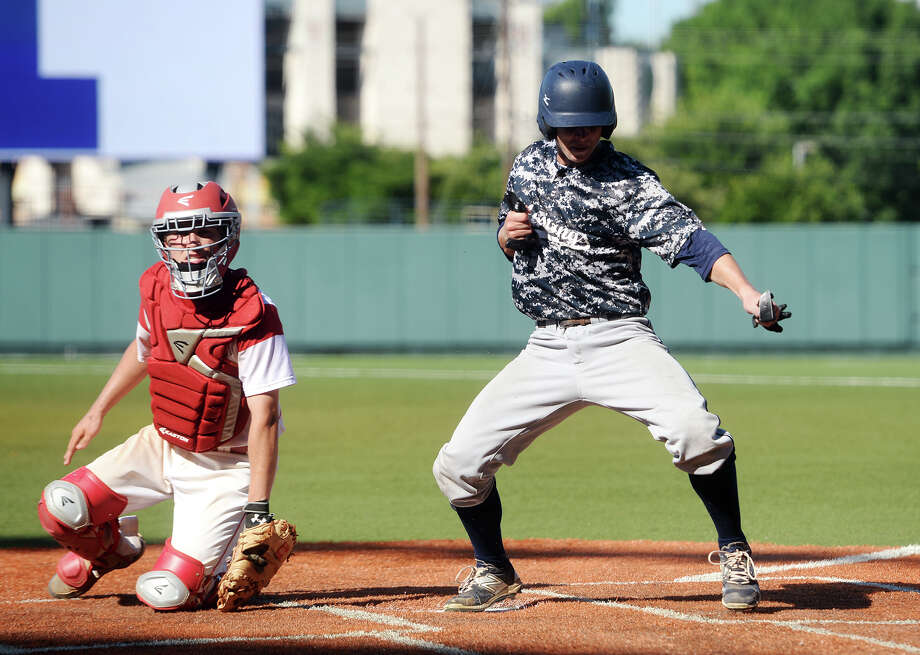 West Orange-Stark's Jack Dallas, No. 3, celebrates his run against El Campo after sliding beneath the Ricebirds' Brylan Crivellari, No. 2, on Wednesday. The West Orange-Stark Mustangs took on the El Campo Ricebirds at UFCU Disch-Falk Field in Austin. The Mustangs beat out the Ricebirds to move onto Thursday's championship game. Photo taken Wednesday 6/10/15 Jake Daniels/The Enterprise Photo: Jake Daniels / ©2015 The Beaumont Enterprise/Jake Daniels