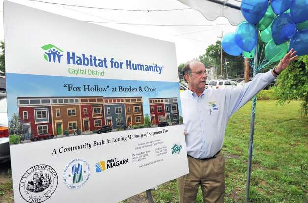 """Executive Director of Habitat for Humanity Capital District Mike Jacobson with an artist's concept of """"Fox Hollow"""",  a new, nine-house development in South Troy during the groundbreaking & project unveiling in Troy Friday July 27, 2012.  (John Carl D'Annibale / Times Union) ORG XMIT: MER2015061111210463 Photo: John Carl D'Annibale / 00018604A"""