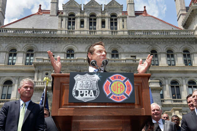 Governor Andrew Cuomo speaks to New York City firefighters and police officers as they rally to demand additional disability protections at the Capitol Wednesday June 10, 2015 in Albany, NY.  (John Carl D'Annibale / Times Union) Photo: John Carl D'Annibale, Albany Times Union / 10032241A