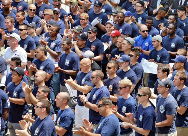 New York City firefighters and police officers cheer as Governor Andrew Cuomo speaks during their rally to demand additional disability protections at the Capitol Wednesday June 10, 2015 in Albany, NY.  (John Carl D'Annibale / Times Union) Photo: John Carl D'Annibale, Albany Times Union / 10032241A