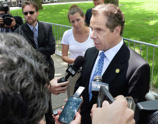 Governor Andrew Cuomo, right, speaks with reporters after attending a rally in support New York City firefighters and police officers at the Capitol Wednesday June 10, 2015 in Albany, NY.  (John Carl D'Annibale / Times Union) Photo: John Carl D'Annibale, Albany Times Union / 10032241A