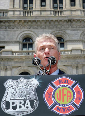 UFA President Steve Cassidy speaks to New York City firefighters and police officers as they rally to demand additional disability protections at the Capitol Wednesday June 10, 2015 in Albany, NY.  (John Carl D'Annibale / Times Union) Photo: John Carl D'Annibale, Albany Times Union / 10032241A
