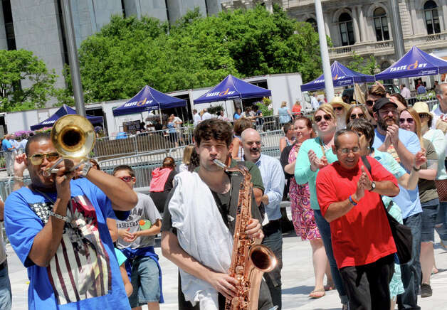 Glen David Andrews, left, and his band lead a New Orleans style second line parade through the Empire State Plaza during their Made in the Shade of the Egg lunchtime show on Wednesday June 10, 2015 in Albany , N.Y.  (Michael P. Farrell/Times Union) Photo: Michael P. Farrell
