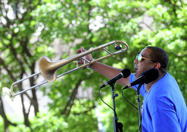 Glen David Andrews and his bring a lot of New Orleans to Albany at the Empire State Plaza during their Made in the Shade of the Egg lunchtime show on Wednesday June 10, 2015 in Albany , N.Y.  (Michael P. Farrell/Times Union) Photo: Michael P. Farrell, Albany Times Union
