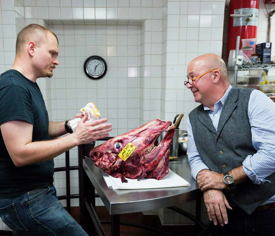 Chef Michael Sohocki of Restaurant Gwendolyn and Andrew Zimmern, host of Travel Channel hit 'Bizarre Foods,' discuss the details of preparing beef brain foie gras for a special San Antonio edition of the show. Photo: Travel Channel /Travel Channel