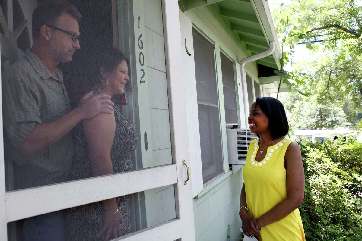 Mayor Ivy Taylor is greeted by Lilia and David Brinkmann Saturday as Taylor visited about 15 houses in District 3 asking for their support in the run-off election against Leticia Van de Putte.
