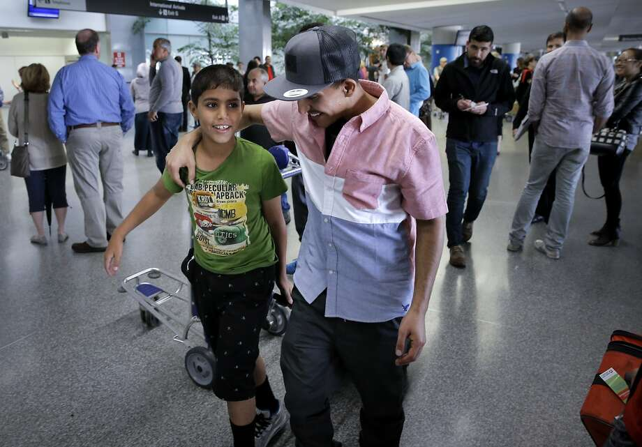 Jaffar Mohsen (center) of Firebaugh (Fresno County) picks up his two brothers Mohamed, 11 (pictured) and Yassin, 19 upon their arrival into San Francisco International Airport, in San Francisco, Calif., on Wed. June 10, 2015, after the two younger brothers were finally were able to escape from war-torn Yemen and return home via Africa. Photo: Michael Macor, The Chronicle