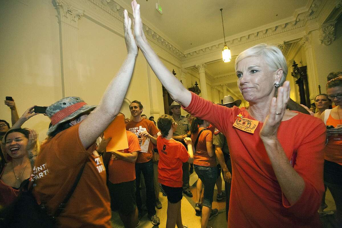 """FILE - In this July 12, 2013 file photo, Cecile Richards, daughter of former Texas Gov. Ann Richards and president of the Planned Parenthood Federation of America, greets abortion rights advocates as they leave the State Capitol rotunda in Austin, Texas. Abortions have declined in states where new laws make it harder to have them - but they've also waned in states where abortion rights are protected, an Associated Press survey finds. Nearly everywhere, in red states and blue, abortions are down since 2010. """"Better access to birth control and sex education are the biggest factors in reducing unintended pregnancies,"""" said Richards. (AP Photo/Tamir Kalifa, File)"""