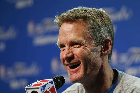 Golden State Warriors head coach Steve Kerr answers a question during press conference for basketball's NBA Finals in Cleveland, Wednesday, June 10, 2015. The Cleveland Cavaliers lead the Warriors 2-1 in the best-of-seven games series.  Game 4 is scheduled for Thursday. (AP Photo/Paul Sancya)