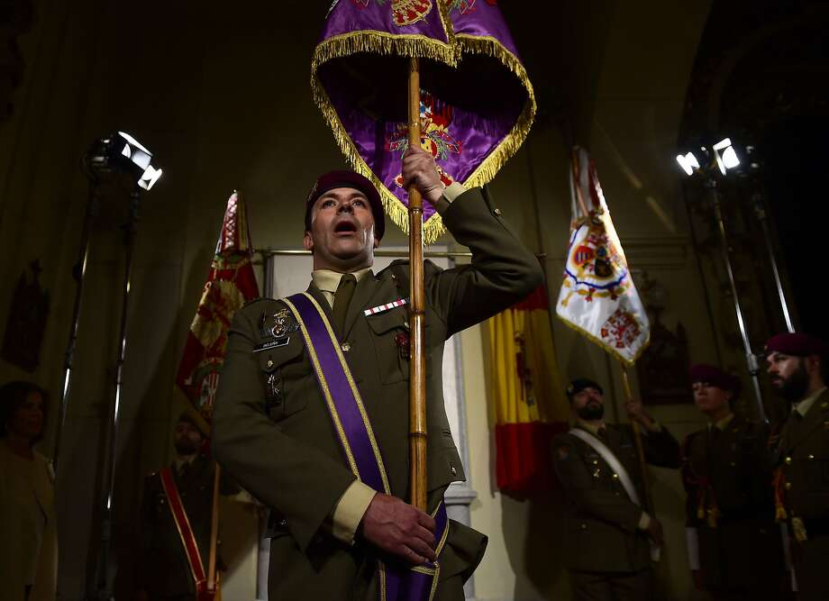 Soldiers take part in a ceremony at the crypt of the Madrid church to inaugurate a memorial plaque marking the place where Spanish writer Miguel de Cervantes' remains were found. Photo: Pierre-Philippe Marcou, AFP / Getty Images