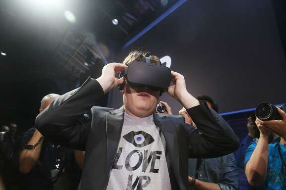 "Palmer Luckey, Oculus founder,  tries on the Oculus Rift  after an Oculus VR news conference ""Step into the Rift' at Dogpatch Studios on Thursday, June 11, 2015 in San Francisco, Calif."