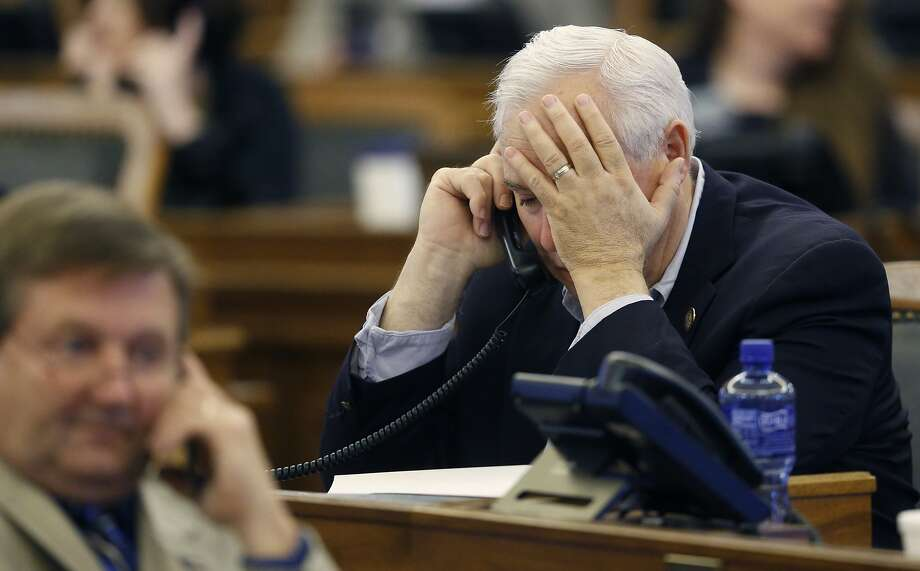 Kansas state Rep. Jerry Lunn talks on the phone before lawmakers reject an increase in taxes. Photo: Bo Rader, Associated Press