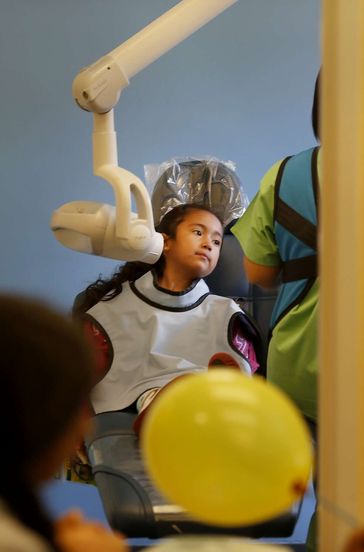 Little Rihana Guardado waits for her x-rays at the the Children's Choice dental office Thursday June 11, 2015. Public health experts want San Francisco, Calif. to be a cavity free zone. The Children's Choice Pediatric Dental Care is one of the few private dental clinics that accepts Medi-Cal coverage and regular insurance plans.