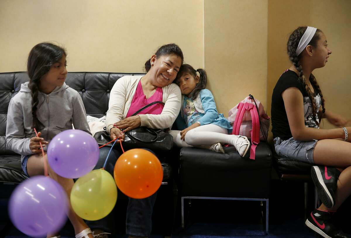 Members of the Castro family pause in the waiting room of the Children's Choice dental office while they await their dates for the next appointments Thursday June 11, 2015. Public health experts want San Francisco, Calif. to be a cavity free zone. The Children's Choice Pediatric Dental Care is one of the few private dental clinics that accepts Medi-Cal coverage and regular insurance plans.