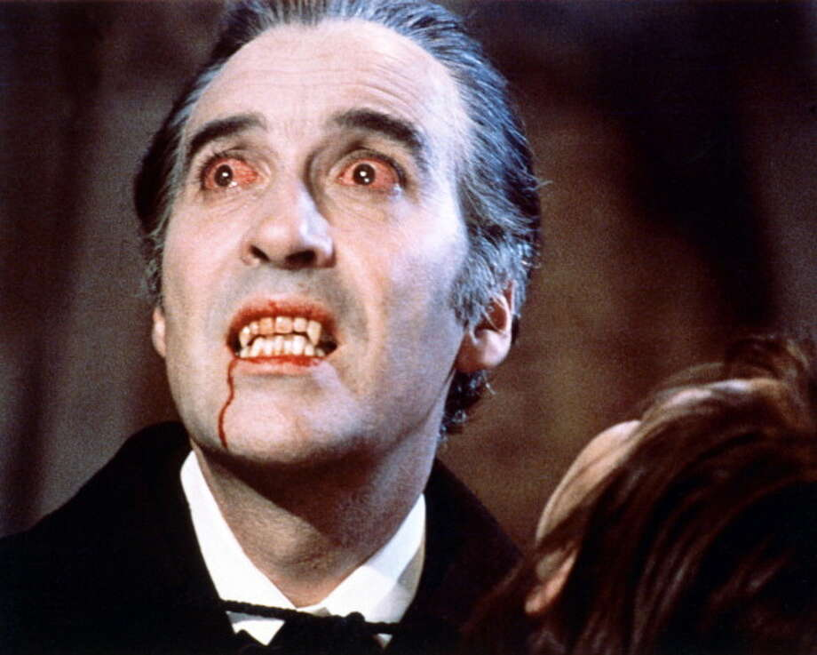 Christopher Lee, British actor, with bloodshot eyes and wearing pale facepaint and vampire's fangs in a publicity still issued for the flilm, 'Dracula', 1958. The Hammer horror film, directed by Terence Fisher (1904–1980), starred Lee as 'Dracula'. (Photo by Silver Screen Collection/Getty Images) Photo: Silver Screen Collection, Getty Images / 2011 Silver Screen Collection