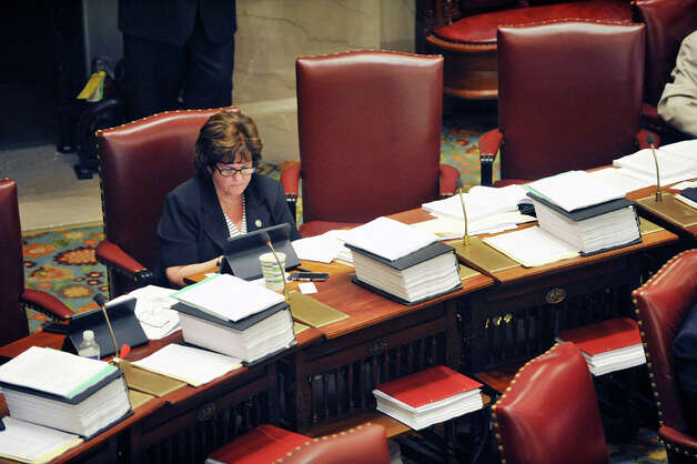 Senator Kathy Marchione works at her desk on the floor of the Senate chambers on Thursday, June 11, 2015, at the Capitol in Albany, N.Y.    (Paul Buckowski / Times Union) Photo: Albany Times Union