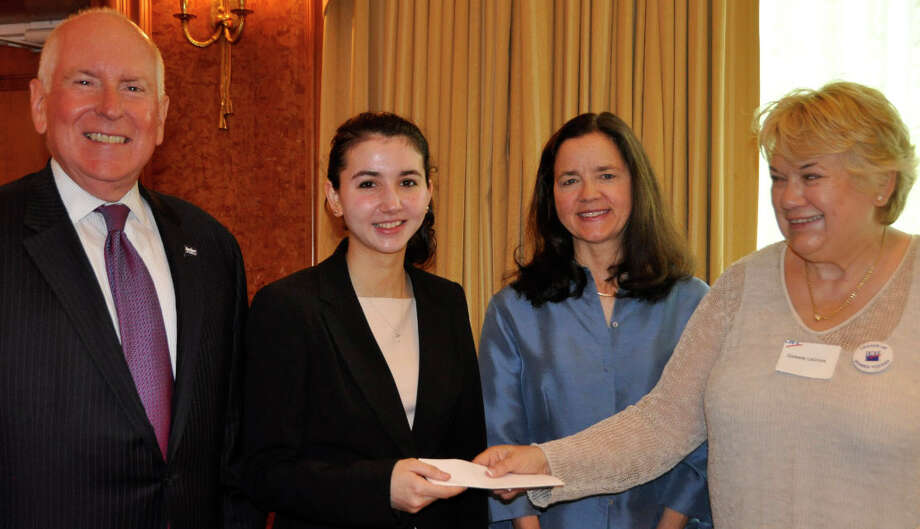 Staples High School senior Jacqueline Chappo, second from left, is presented with the League of Women Voters' Staples Tuition Grant. At the recent event were, from left, First Selectman Jim Marpe, Chappo, her mother Anna and LWV President Celeste LaCroix. Photo: Contributed Photo / Westport News