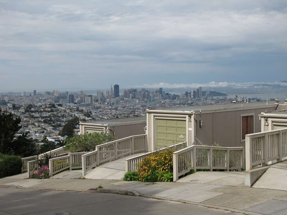 Houses in the 100 block of Topaz Way in the Diamond Heights district are modest when seen from the sidewalk, but the view from the rear is a sculptural wall of elongated wood forms -- neither of which can compete with the panoramic bay views to the east. Photo: John King, The Chronicle