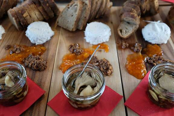 """At one of S&M Vegan Chefs' """"Blind Tiger"""" underground dinners, Bison beer slate with cashew cheese, assorted mushroom confit, apricot compote and chocolate stout bread."""
