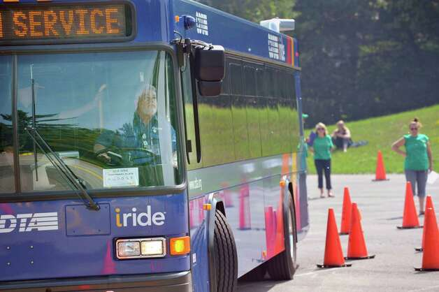Bus driver, Mike Stever, backs his bus up as Capital District Transportation Authority bus drivers compete in the CDTA Roadeo Championship on Thursday, June 11, 2015, in Albany, N.Y. Drivers were scored in ten different driving challenges, and were given a certain amount of time to finish the course. Stever has been a bus driver for six years.    (Paul Buckowski / Times Union) Photo: PAUL BUCKOWSKI / 00032238A