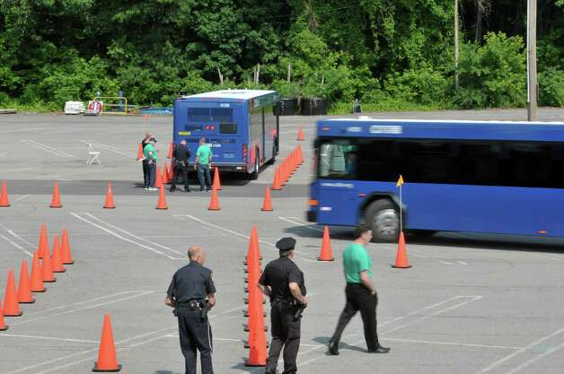 Drivers make their way through the course as Capital District Transportation Authority bus drivers compete in the CDTA Roadeo Championship on Thursday, June 11, 2015, in Albany, N.Y. Drivers were scored in ten different driving challenges, and were given a certain amount of time to finish the course.    (Paul Buckowski / Times Union) Photo: PAUL BUCKOWSKI / 00032238A