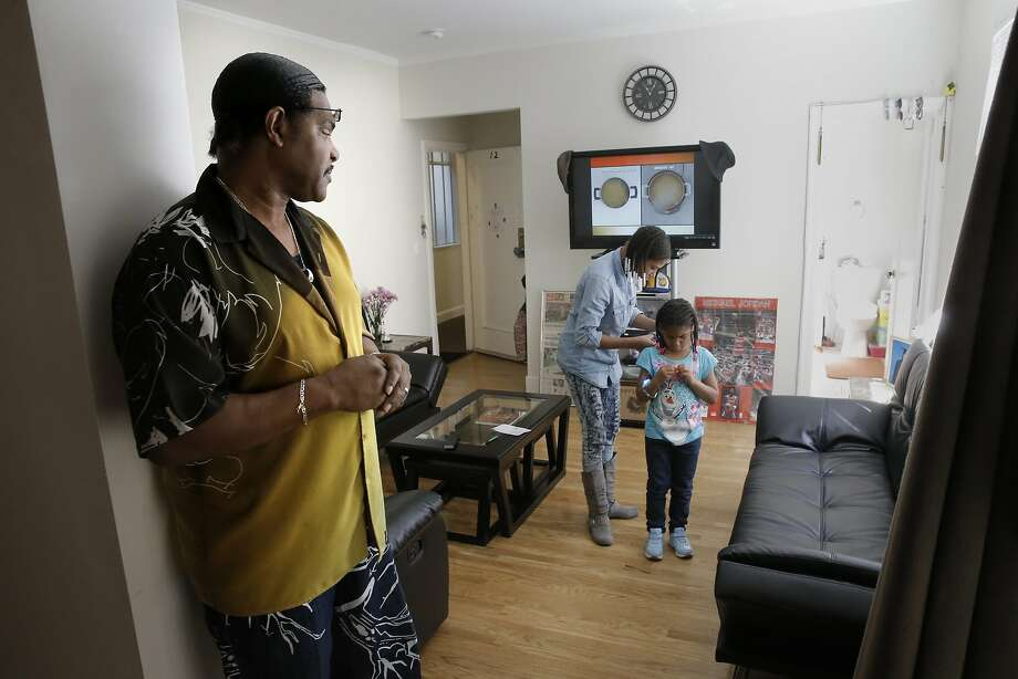 Reynaldo Peppars, a single dad, in the Turk St. apartment he shares with his two daughters, Veneeta, 13, and Marshey, 6 in San Francisco, Calif., as seen on Thurs. June 11, 2015. The City of San Francisco has quietly managed to house hundreds of poor and homeless families over the past year with a special $2 million state grant from CalWORKS that gives them the money to help cover rent in astonishingly expensive San Francisco. Photo: Michael Macor, The Chronicle