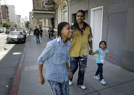 Reynaldo Peppars, a single dad, with his two daughters, Veneeta, 13, and Marshey, 6  as they walk through the Tenderloin near their Turk St. apartment in San Francisco, Calif., as seen on Thurs. June 11, 2015. The City of San Francisco has quietly managed to house hundreds of poor and homeless families over the past year with a special $2 million state grant from CalWORKS that gives them the money to help cover rent in astonishingly expensive San Francisco.