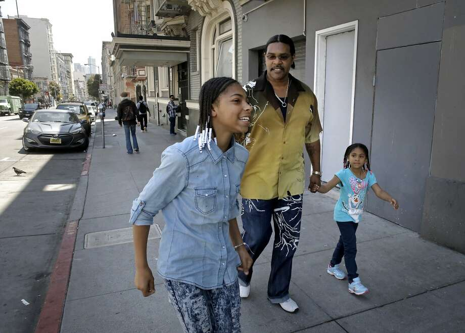 Reynaldo Peppars, a single dad, with his two daughters, Veneeta, 13, and Marshey, 6  as they walk through the Tenderloin near their Turk St. apartment in San Francisco, Calif., as seen on Thurs. June 11, 2015. The City of San Francisco has quietly managed to house hundreds of poor and homeless families over the past year with a special $2 million state grant from CalWORKS that gives them the money to help cover rent in astonishingly expensive San Francisco. Photo: Michael Macor, The Chronicle
