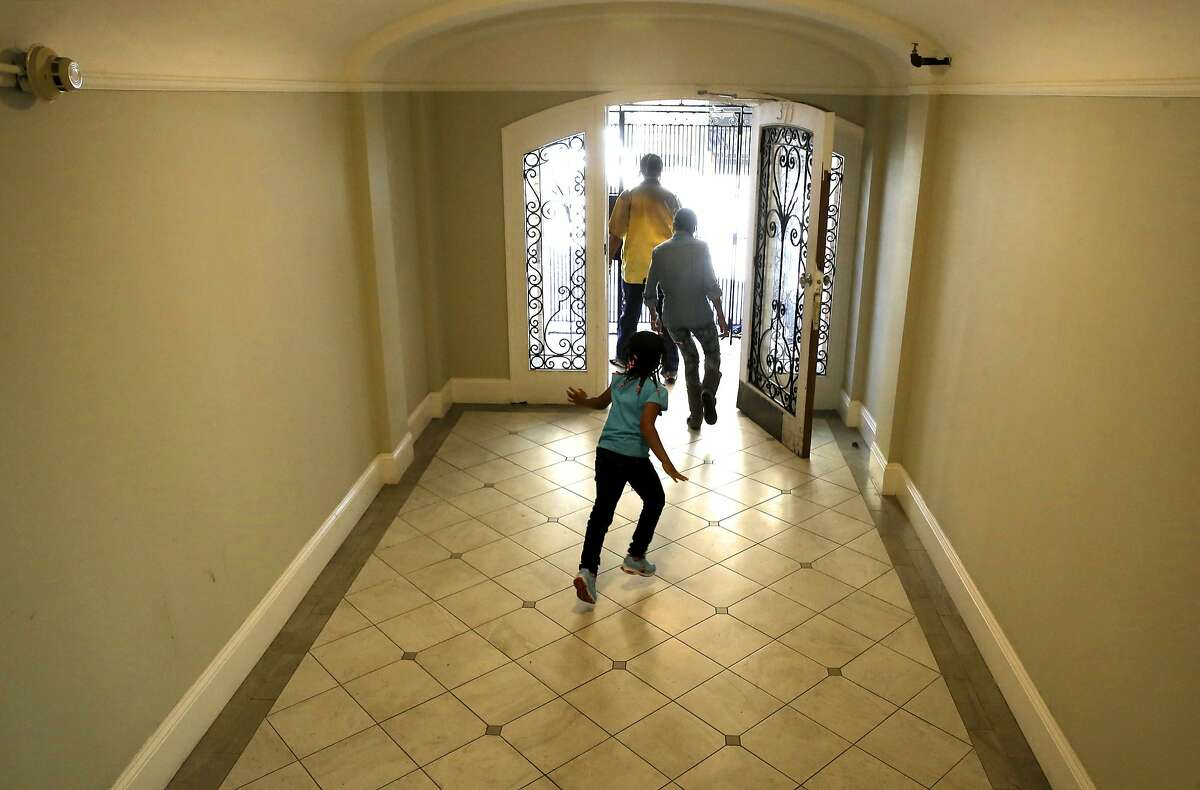 Reynaldo Peppars, a single dad, leaving their Turk St. apartment building where he shares a unit with his two daughters, Veneeta, 13, and Marshey, 6 in San Francisco, Calif., as seen on Thurs. June 11, 2015. The City of San Francisco has quietly managed to house hundreds of poor and homeless families over the past year with a special $2 million state grant from CalWORKS that gives them the money to help cover rent in astonishingly expensive San Francisco.