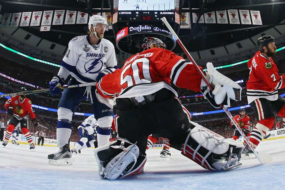 Tampa Bay's Steven Stamkos (left) has been frustrated by Chicago goalie Corey Crawford (50) — oneof the Lightning's best offensive players hasn;t scored a goal yet in the Finals. Photo: Bruce Bennett, Getty Images