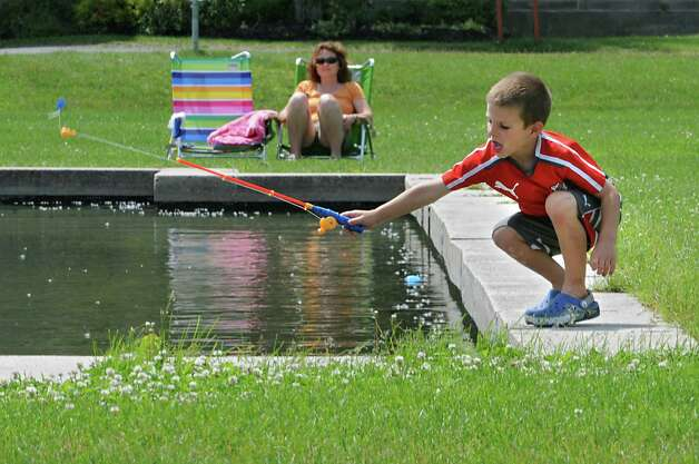 Babysitter Shannon Hmura of Saratoga Springs keeps a close eye on Dominic Damiano, 5, of Saratoga Springs as he cast his fishing line into the water at the Saratoga Spa State Park on Thursday, June 11, 2015 in Saratoga Springs, N.Y. (Lori Van Buren / Times Union) Photo: Lori Van Buren