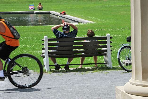 Anthony Fischatti of Saratoga Springs and his wife Carol take a break from riding their bikes and watch 5-yr-old Dominic Damiano of Saratoga Springs play in the water at the Saratoga Spa State Park on Thursday, June 11, 2015 in Saratoga Springs, N.Y. Babysitter Shannon Hmura of Saratoga Springs keeps a close eye on Dominic. The Fishatti's have been biking in this park for over 20 years and are happy about the extended new trails. (Lori Van Buren / Times Union) Photo: Lori Van Buren