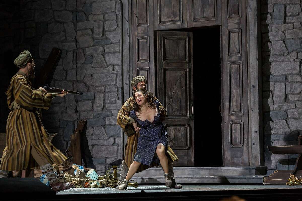 """""""Cesira"""" played by Anna Caterina Antonacci, center, is accosted by Moroccan mercenaries raped in a church in act 2 scene 2 during a performance of """"Two Women"""" at the War Memorial Opera House in San Francisco, Calif., Tuesday, June 9, 2015."""