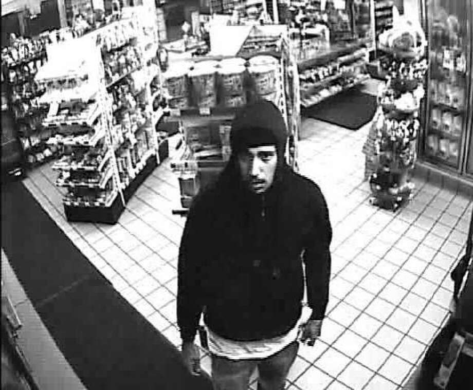Police are looking for two men who they say tried to rob a San Francisco gas station in May and then shot at the clerk when he attempted to flee. Photo: Courtesy, San Francisco Police Department