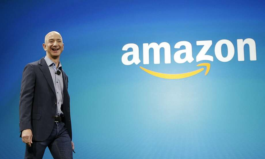 FILE - In this June 16, 2014 file photo, Amazon CEO Jeff Bezos walks on stage for the launch of the new Amazon Fire Phone, in Seattle. Amazon.com reports quarterly financial results on Thursday, Oct. 23, 2014. (AP Photo/Ted S. Warren, File) Photo: Ted S. Warren, Associated Press