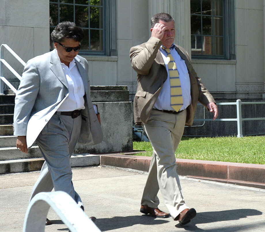 Bo Kelley exits the federal courthouse accompanied by one of his lawyers after his sentencing on federal wire fraud charges Thursday. Photo taken Thursday, June 11, 2015 Kim Brent/The Enterprise Photo: Kim Brent / Beaumont Enterprise