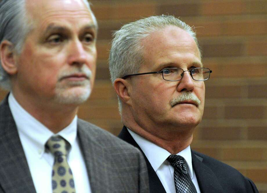 Brookfield's former school finance director Art Colley, right, appears in state Superior Court in Danbury with his attorney Eugene Riccio. Photo: Carol Kaliff / Carol Kaliff / The News-Times