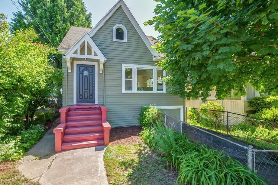 The first home, 8720 16th Ave. N.W., is listed for $415,000. The two bedroom, one bathroom home is full of unique touches, such as rounded archways and a wood-paneled master bedroom. 