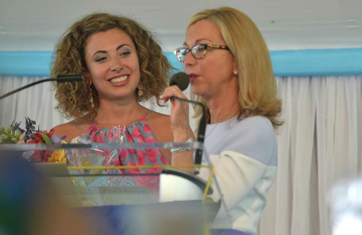 Daneem Grabe thanks speaker Loryne Atovi-Laham at the Rose of Hope Luncheon, to benefit the Norma Pfriem Breast Cancer Center, in Fairfield, Conn. on June 11, 2015. Loryne Atovi-Laham shared the story of her motherâÄôs battle with breast cancer during a time of war in their home country of Lebennon.