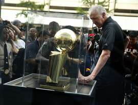 Bill Walton looks at the Larry O'Brien Trophy before Golden State Warriors play Cleveland Cavaliers in Game 4 of NBA Finals' at Quicken Loans Arena in Cleveland, Ohio, on Thursday, June 11, 2015.