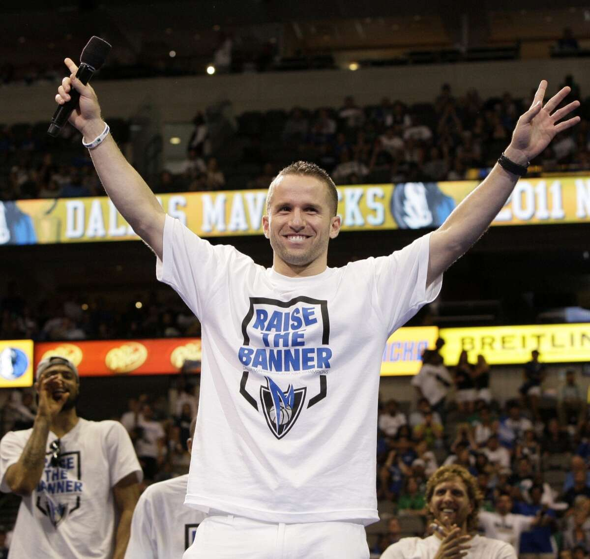 Dallas Mavericks' Jose Juan Barea of Puerto Rico, acknowledges cheers from fans during a rally at American Airlines Center following the team's NBA Championship victory parade Thursday, June 16, 2011, in Dallas.