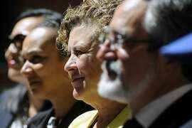 Supervisor Julie Christensen listens to speakers during the grand opening celebration of the new affordable family rental housing Broadway Sansome Apartments in San Francisco, CA Thursday, June 11, 2015.