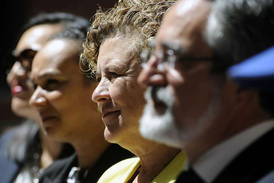 Supervisor Julie Christensen listens to speakers during the grand opening celebration of the new affordable family rental housing Broadway Sansome Apartments in San Francisco, CA Thursday, June 11, 2015. Photo: Michael Short, Special To The Chronicle
