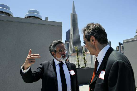 Former supervisor Aaron Peskin, left, tours the rooftop deck with architect Daniel Solomon during a grand opening celebration of new affordable family rental housing Broadway Sansome Apartments in San Francisco, CA Thursday, June 11, 2015.