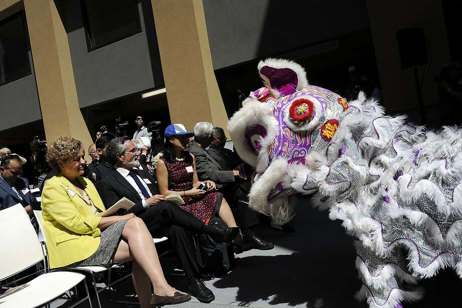 Supervisor Julie Christensen, left, and Aaron Peskin watch a lion dance from Leung's White Crane Association during the grand opening celebration of the new affordable family rental housing Broadway Sansome Apartments in San Francisco, CA Thursday, June 11, 2015. Photo: Michael Short, Special To The Chronicle