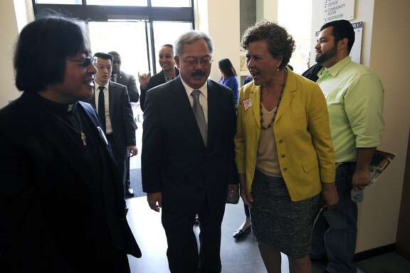 Supervisor Julie Christensen, right, greets Mayor Ed Lee as he arrives for the grand opening celebration of the new affordable family rental housing Broadway Sansome Apartments in San Francisco, CA Thursday, June 11, 2015.