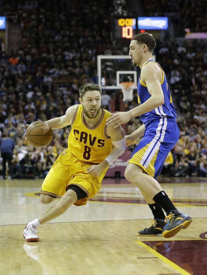 Cleveland Cavaliers guard Matthew Dellavedova (8) drives on Golden State Warriors guard Klay Thompson (11) during the first half of Game 3 of basketball's NBA Finals in Cleveland, Tuesday, June 9, 2015. (AP Photo/Tony Dejak) Photo: Tony Dejak, Associated Press