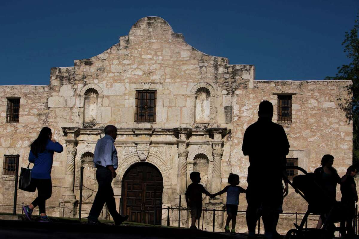 Tourists walk by the Alamo in San Antonio, TX on Thursday, April 30, 2015.