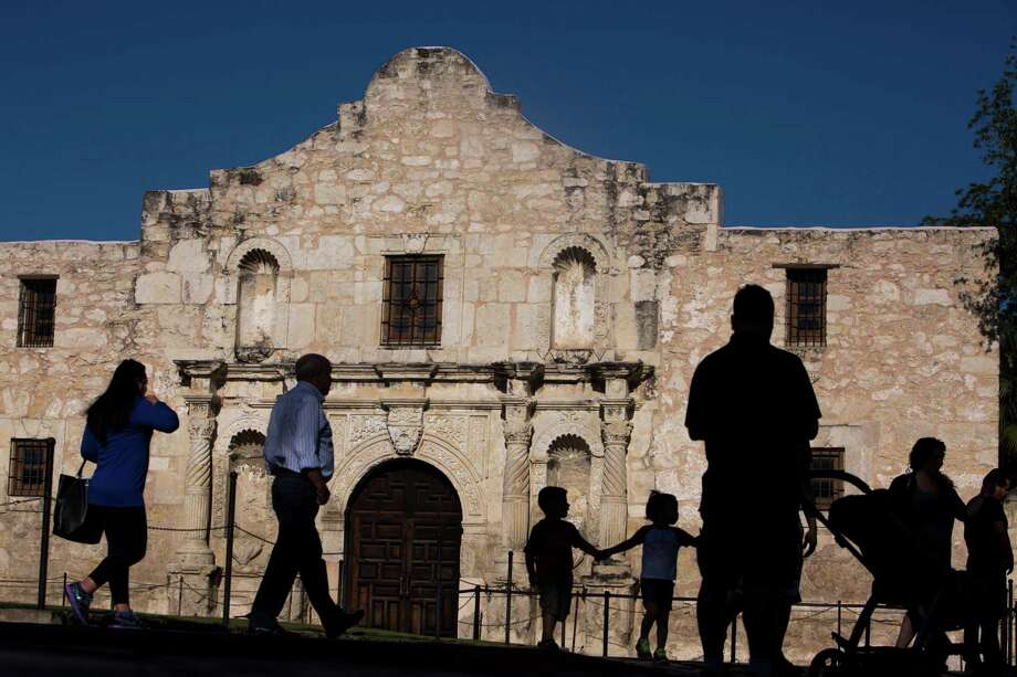 Tourists walk by the Alamo in San Antonio, TX on Thursday, April 30, 2015. Photo: Carolyn Van Houten, Staff / San Antonio Express-News / 2015 San Antonio Express-News