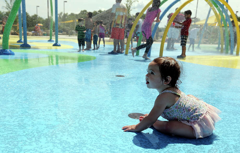 Norah Adams, 11-months, cools off on June 8 in the sprayground area at Fischer Park in New Braunfels. Photo: Edward A. Ornelas /San Antonio Express-News / © 2015 San Antonio Express-News